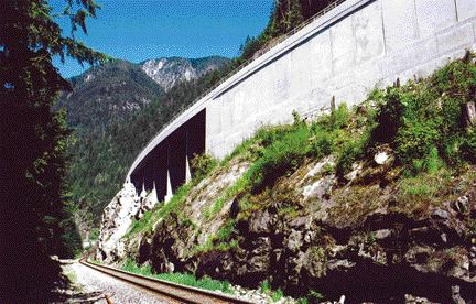 """one of two concrete """"half-bridges,"""" adjacent to a hybrid retaining wall system."""