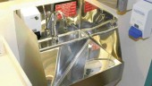 """the stainless steel unit has rounded corners and steep slopes to drain; the standard """"P"""" trap was replaced with a horizontal ultraviolet tube."""