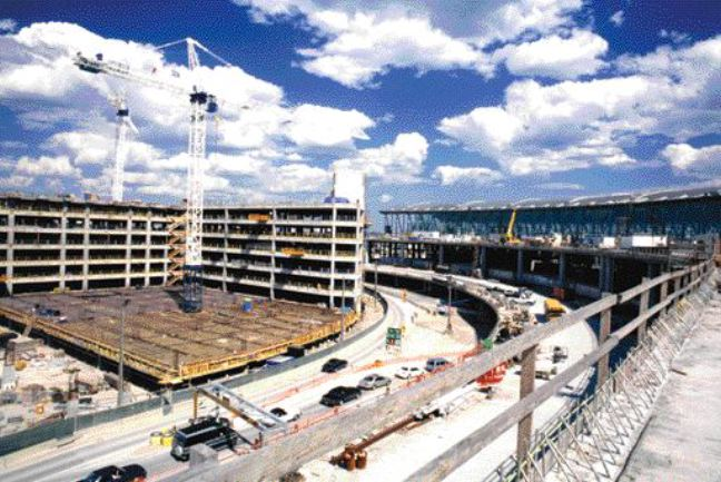 parking (left) and new Terminal 1 under construction.