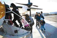 People leaving Kashechewan, northern Ontario, in early November.