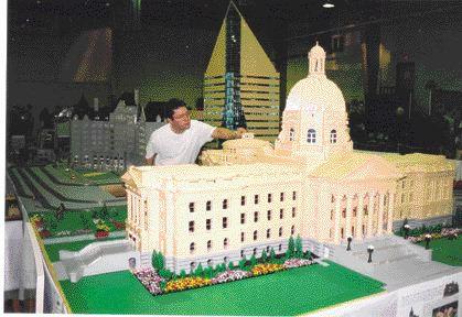 Koob and a 1/40 scale model of the Alberta Legislature building.