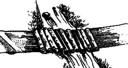 Traditional corduroy log bridges.