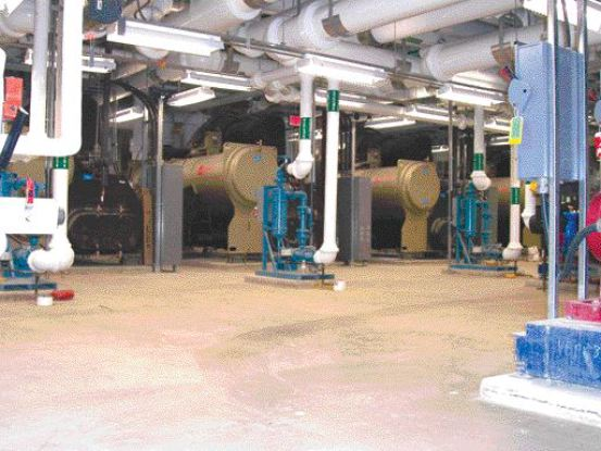 Chiller room with 1000-ton chillers and cyclone filter assemblies for respective cooling towers.