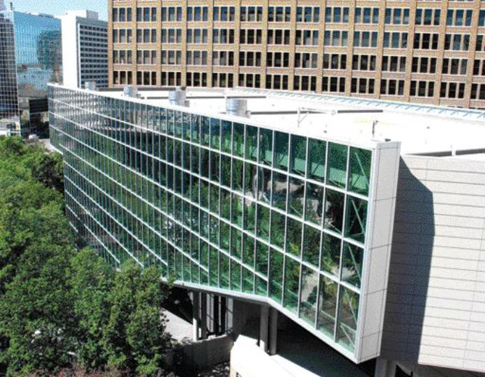 New southeast face of building with its full glass addition.