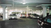 interior of a parkade with few obstructions and light-reflective paint on walls, floor and ceilings to create a bright, open and safe feeling for users.