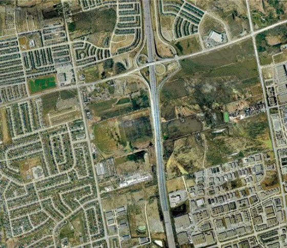 Highway 400 & Rutherford Road - same area in 2002; fields make way for development.