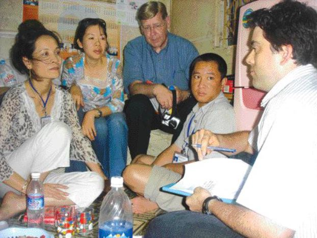 Dr. Fredlund with staff at the AIDS clinic in Hanoi.