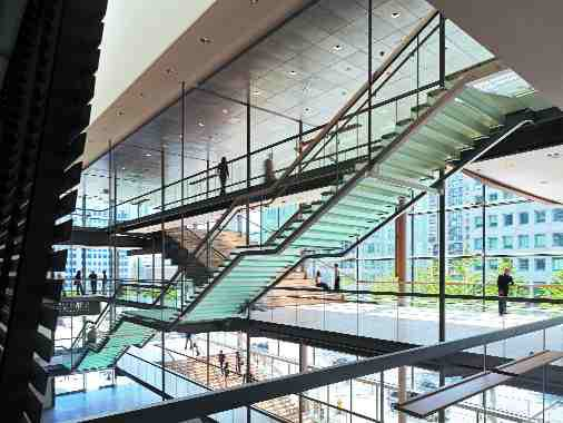 """""""City Room"""" foyer with glass stair."""