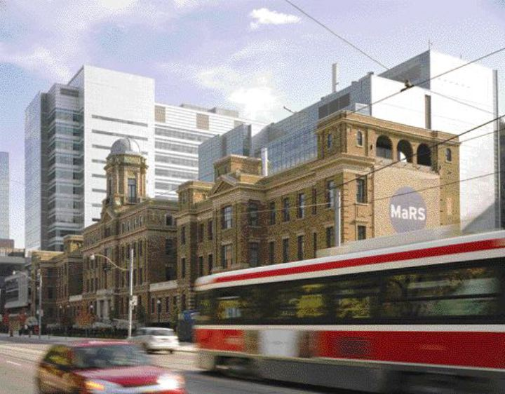 A historical hospital building on College Street forms the centrepiece of the MaRS Centre complex, with the new towers surrounding it.