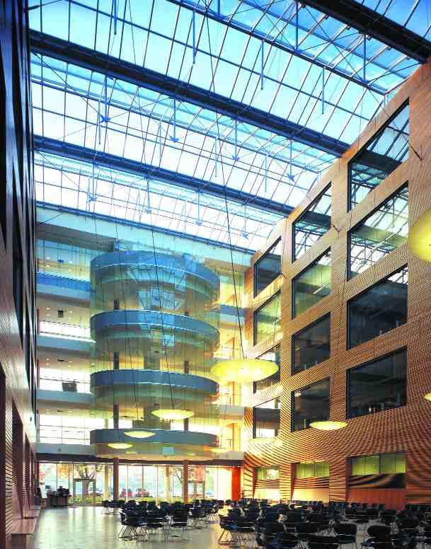 """One of the two large atriums between the laboratory blocks; these spaces have no air-conditioning, only """"free"""" cooling."""