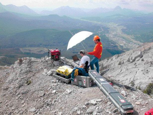 Team members on the summit operate a televiewer to characterize the bedrock conditions.
