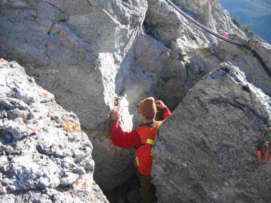 Installing tiltmeters in the deeply fissured rock.