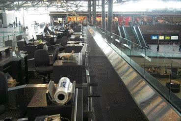 Baggage check-in at Ottawa Macdonald-Cartier International Airport.