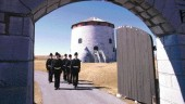 Cadets in period costume parade near the Murney Martello Tower in Kingston, Ontario.