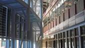 atrium with solar panel glazing at left.