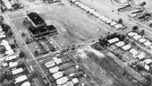 """Infrared aerial photo of Love Canal area in Niagara Falls, NY, 1978. The elementary school in centre had been built over the filled-in channel. Image from """"A Special Report to the Governor & Legislature: Love Canal, NY State Dept. of Health, David Axelrod, MD, 1981."""""""