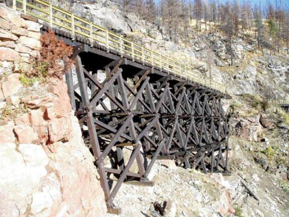 Reconstructed trestle No. 15; the replacement timber structures have to meet new codes, which means new foundations have to be constructed in difficult and varying terrain.
