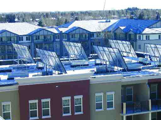 Glazed flat plate solar collectors on the roof of the Gateway South Centre residential development off MacLeod Trail South in Calgary; the collectors heat domestic hot water and provide supplementary heat for a geothermal system.