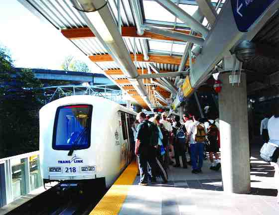 Passengers board a light rapid transit (LRT) train at the Commercial SkyTrain Station in Vancouver.