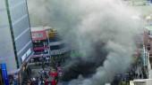 Smoke billows into a street in Daegu city, South Korea during a fatal subway fire, February 18, 2005.