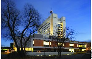 Evening view of the 12-storey 1970s hospital block after the envelope and perimeter areas had been completely decontaminated and reconstructed.