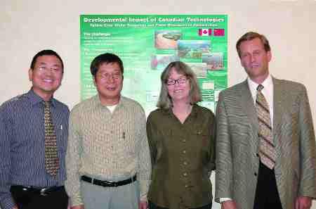 10 Yellow River Water Resources and Flood Management Study, China. Golder Associates, Calgary. Left to right: Dr. Dejiang Long, Dr. Hua Zhang, Susan Ross, Robert van Wyngaarden.
