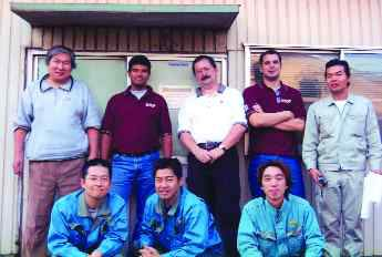 9. Goodfellow EFSOP Project, Topy Industries' Toyahashi Factory, Japan. Tenova Goodfellow, Mississauga, Ontario. Back row, second, third and fourth from left: Marshall Khan, Ovidiu Negru, Vittorio Scipolo. The remaining individuals (dressed in grey and blue) are Topy Industries personnel.