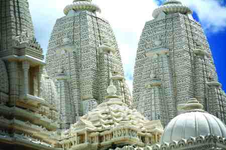 Intricate limestone carvings cover the multiple domes and peaks on the roof.