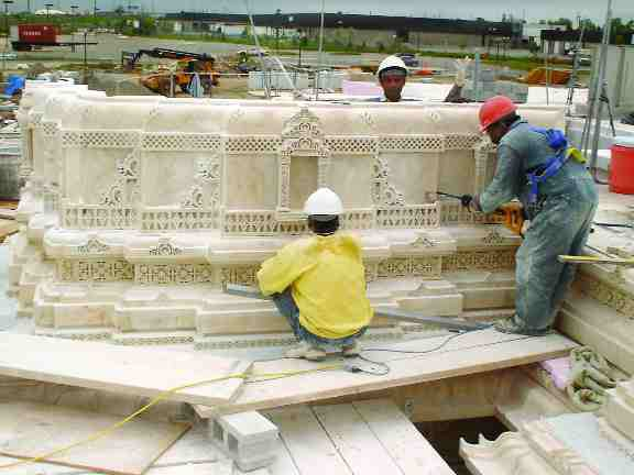 Stonework in progress; 100 craftsmen were brought from India to help construct the temple.