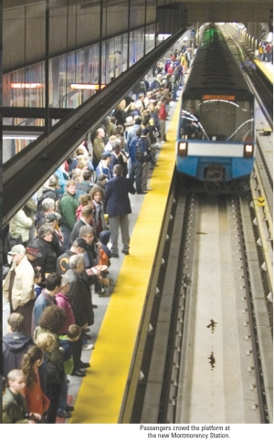 Passengers crowd the platform at the new Montmorency Station.