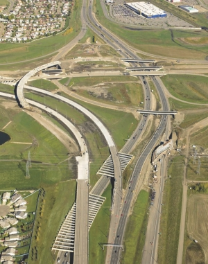 Right: aerial view, with two trellis structures in foreground; the roadway over the perpendicular beams can be easily widened in future.