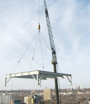 Crane lowers the base for the new combined heat and power plant.