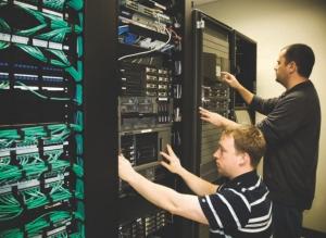 ISL staff (David Stoddart and Pasquale Saccomanno) checking server equipment.