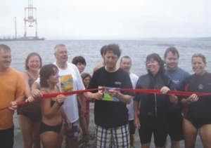 Officials open a beach for swimming on a rainy August 2 in Halifax.