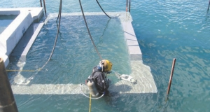 Divers help to install precast units. Over 500 units were used.