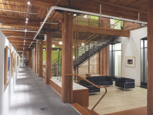 Lobby area, with post and beam structure and salvaged wooden slat screens.