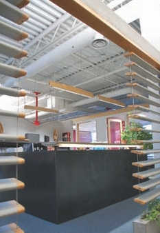 """Reception Area. Concrete louvres were designed in-house and specially fabricated. """"We worked with a friend of mine who made some small stainless steel forms,"""" explains Fast."""