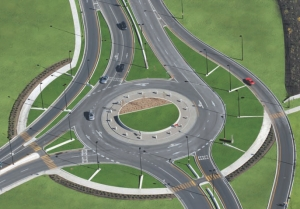 The roundabout is a creative three branch circle with bypass lanes that increase the smooth traffic flow; a mountable apron at the centre allows oversize trucks to pass.