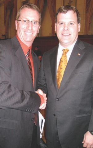 ACEC President Jeff Morrison meets with the Hon. John Baird, Minister of Transport, Infrastructure and Communities.