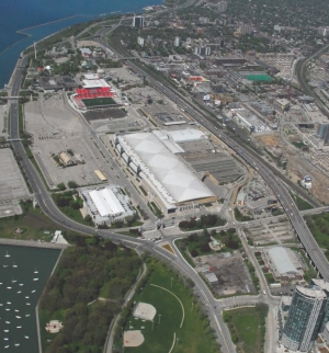 Aerial view of the showgrounds and its many venue buildings. The Direct Energy Centre is the largest exposition hall with the white roof.