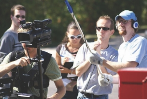 Above: filming Among Thieves in Winnipeg. Paul Boge is second from right, with co-producers Chris Radtke (left, behind camera) and Timothy Horch (right, holding boom).