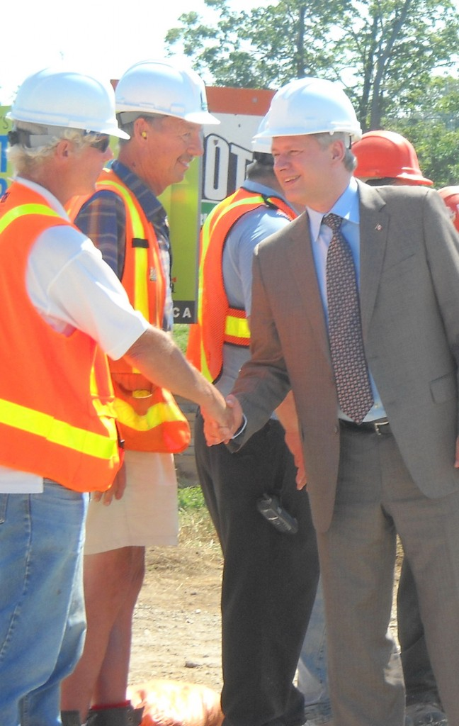 Prime Minister Stephen Harper (right) shakes hands with Peter Jones of Morrison Hershfield.