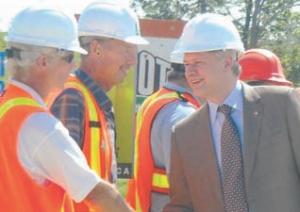 Prime Minister Stephen Harper with Peter Jones of Morrison Hershfield (left).