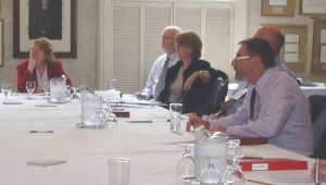 Above: decision time -- the judges discuss the finalist projects round the table at the Albany Club in downtown Toronto.