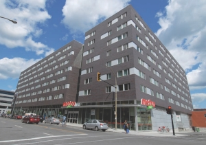 Building at De La Montagne and Notre-Dame Streets in Montreal. Energy recovered from the grocery store is used to heat 266 university residences above.