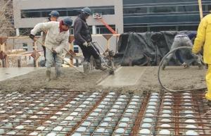 Pouring concrete over the BubbleDeck system.
