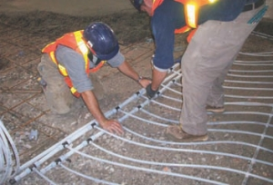 """Laying the radiant """"mat"""" of hydronic pipe."""