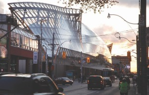 """Above: view along Dundas Street West shows curved facade with """"wings"""" at each end and lower """"skirt."""""""