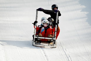 The McMaster Outlaws race downhill in the 36th Great Northern Concrete Toboggan Race.