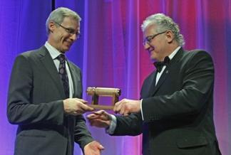 Dr. Jim Montgomery (left) receiving his award from Art Washuta.
